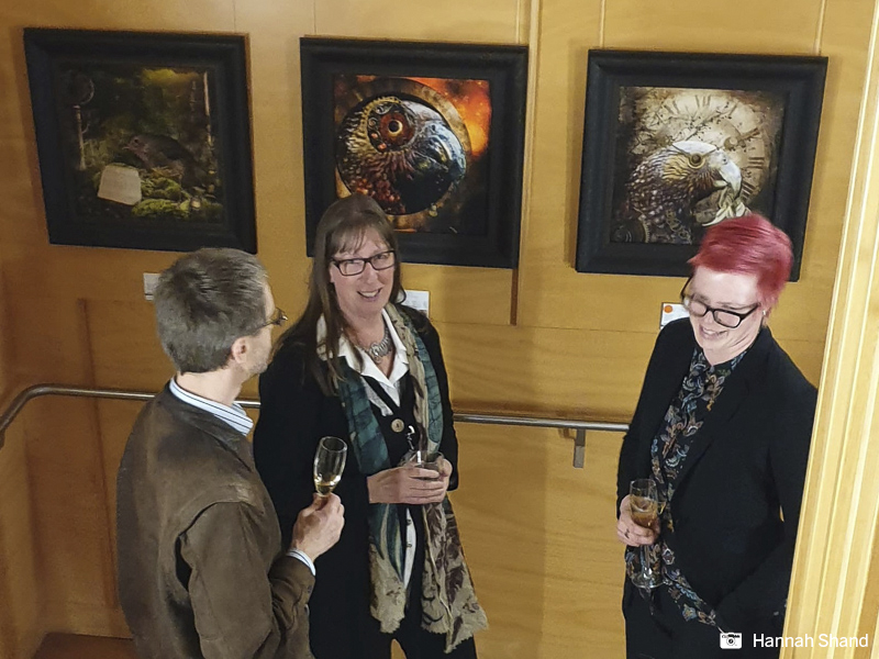 Guests meet local artist Judi Lapsley Miller on her opening night for her Visions of Zealandia 2 show